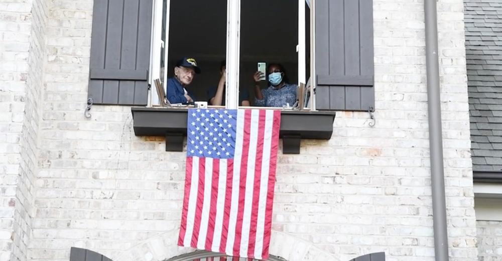 Navy veteran Samuel Greco celebrates his birthday from his second-story room.