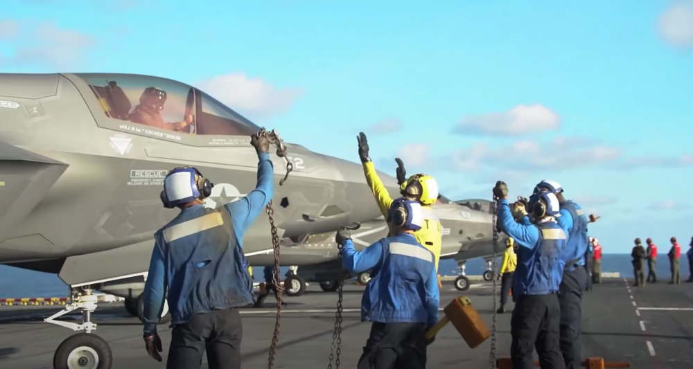 The flight crew aboard the USS Makin prepares a F-35B Lightning II  for takeoff.