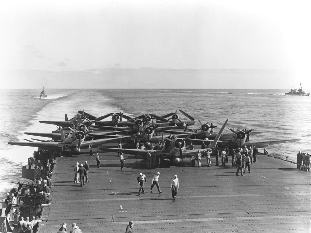 U.S. Navy Torpedo Squadron 6 (VT-6) Douglas TBD-1 Devastator aircraft are prepared for launching aboard the aircraft carrier USS Enterprise.