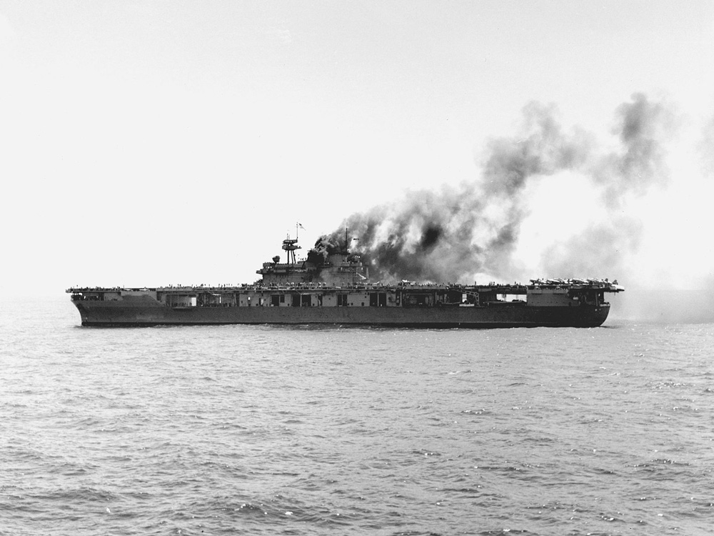 The U.S. Navy aircraft carrier USS Yorktown (CV-5) burning after the first attack by Japanese dive bombers during the Battle of Midway.