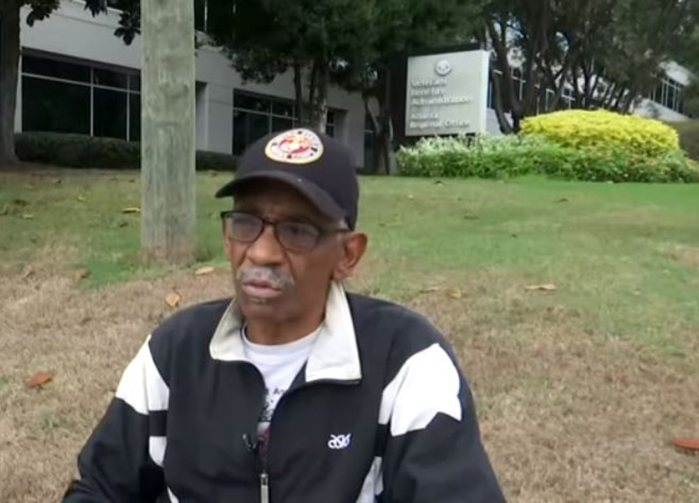 Marine veteran John L. Davis suffers from a skin condition likely caused by the water at Camp Lejeune.
