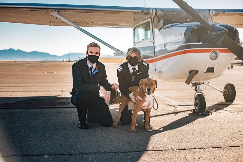 Pilot Cody Anderson, left, is flying shelter pets to their new forever homes in New Mexico.