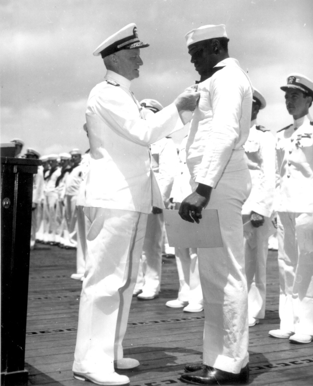 Miller was awarded the Navy Cross by Admiral Chester W. Nimitz, Commander-in-Chief of the U.S. Pacific Fleet.