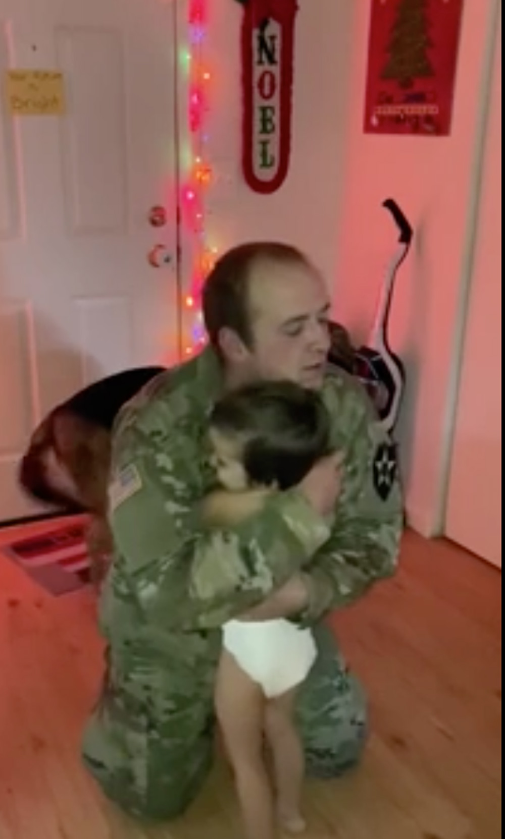 The boy gets a quick hug from dad.
