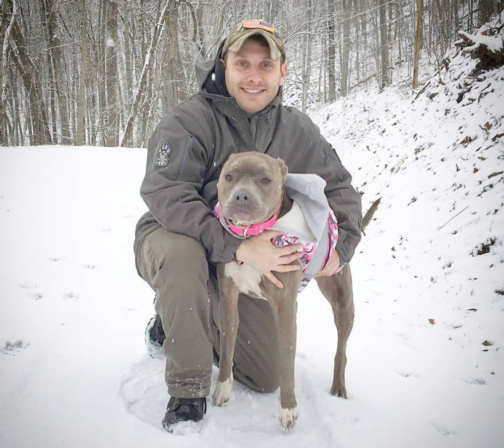 Army infantry veteran Justin Tucker and hid PTSD service dog Roxy.