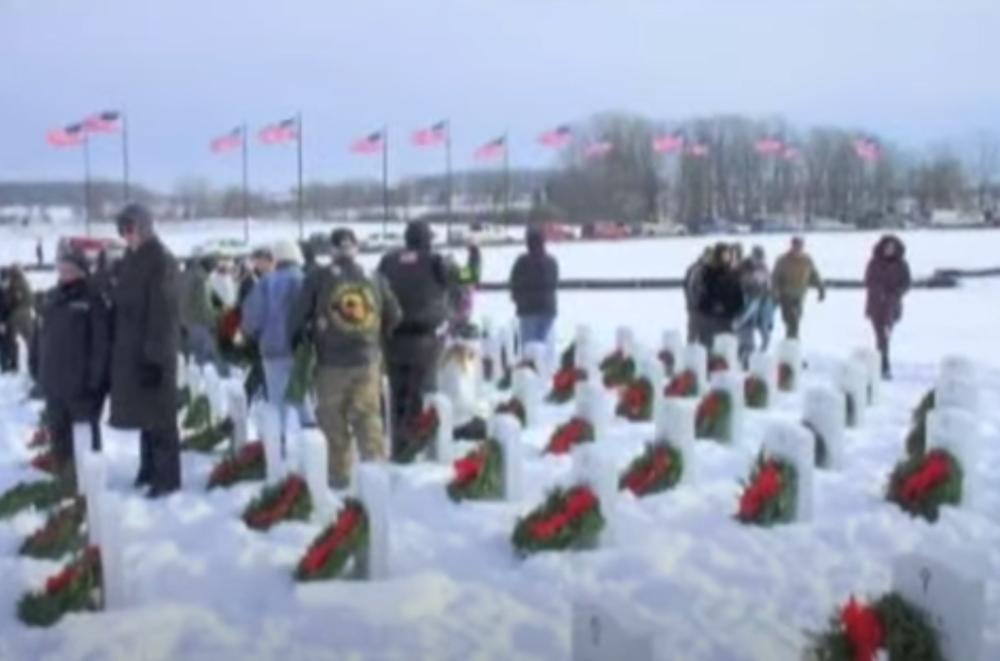 Volunteers help decorate veterans graves for WAA Day.