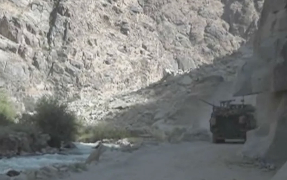 Troops in armored vehicles moving through the Baghak Valley.