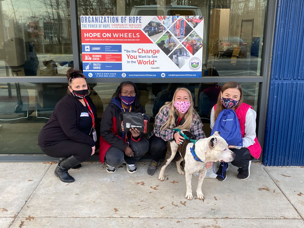 Staff with Pet Packs and Dog at BARCS Distribution.