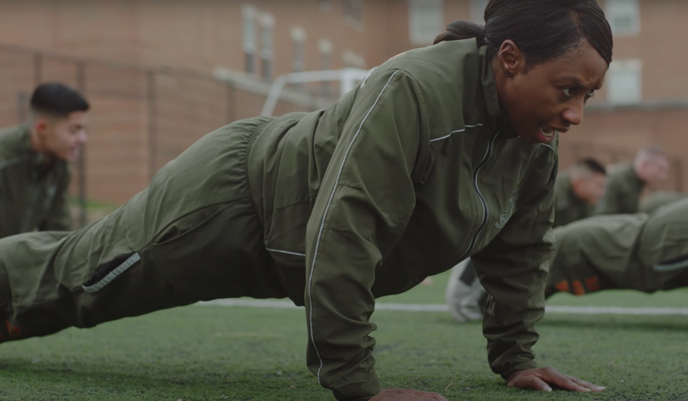 "every female Marine is instilled with the traditional esprit de corps of their male counterparts: ""Once a Marine, always a Marine."""