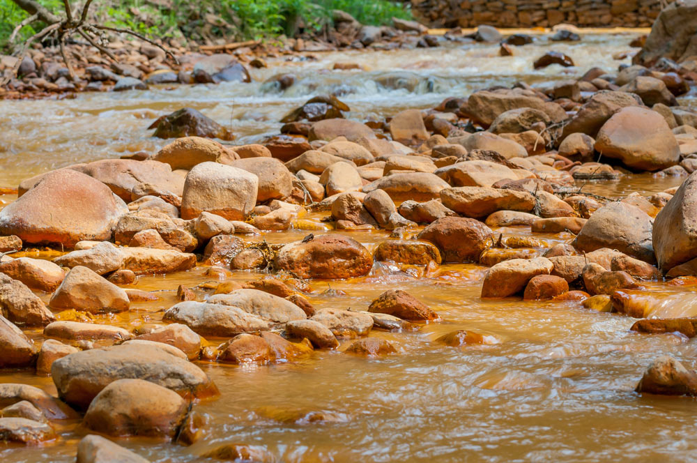 Pollution from mining muddies a freshwater stream.