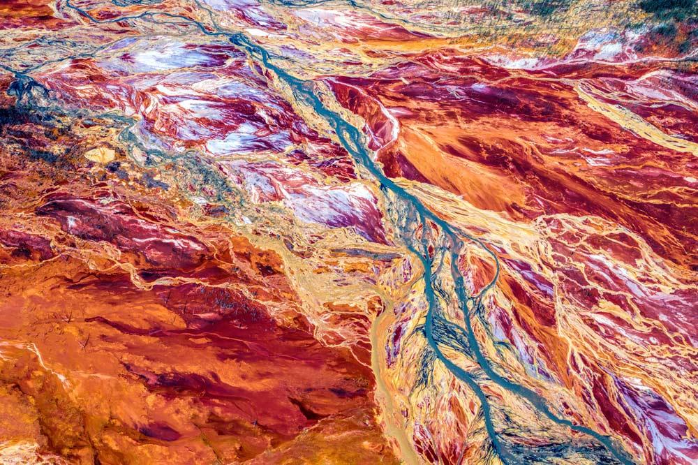 Mining pollution leaves dark marks on the natural landscape.