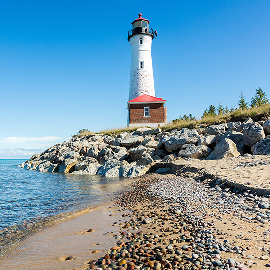 Lighthouses dot the coast of these large inland freshwater lakes.