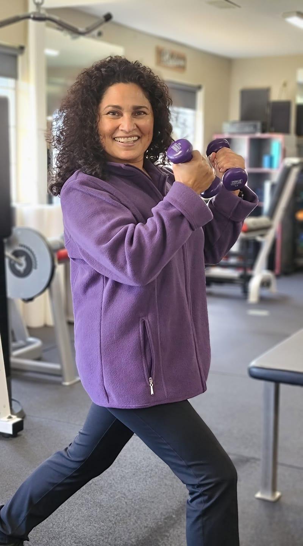 Rhonda Murphy posing with dumbbells