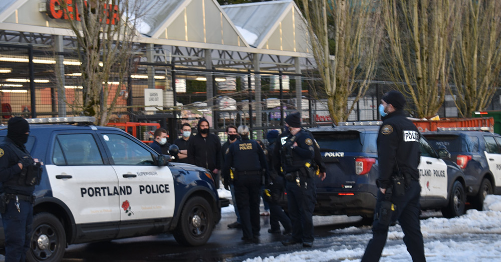 Police stand around a Fred Meyer store in Portland, Oregon.