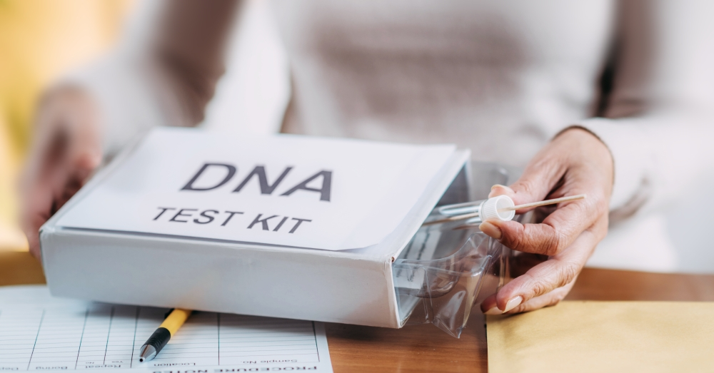 Woman opens DNA test kit box for genetic testing