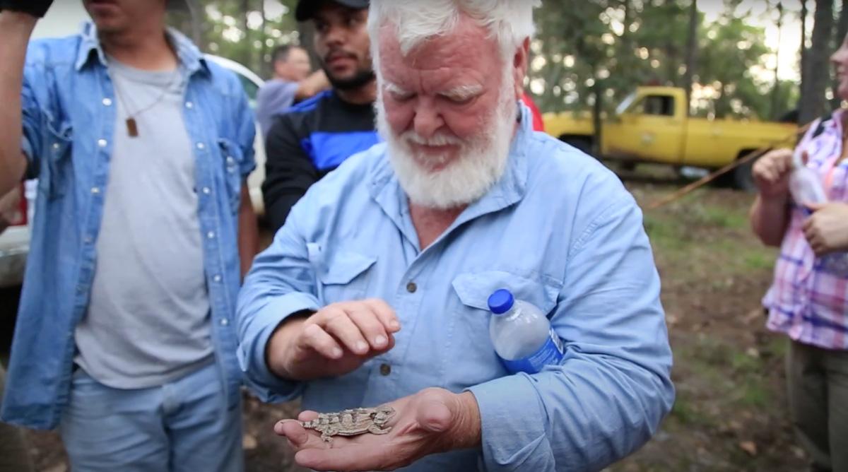 Van Devender holds a salamander.
