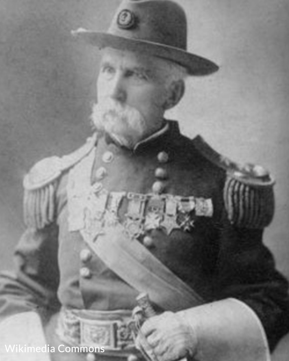 Chamberlain later in life with his Civil War uniform.