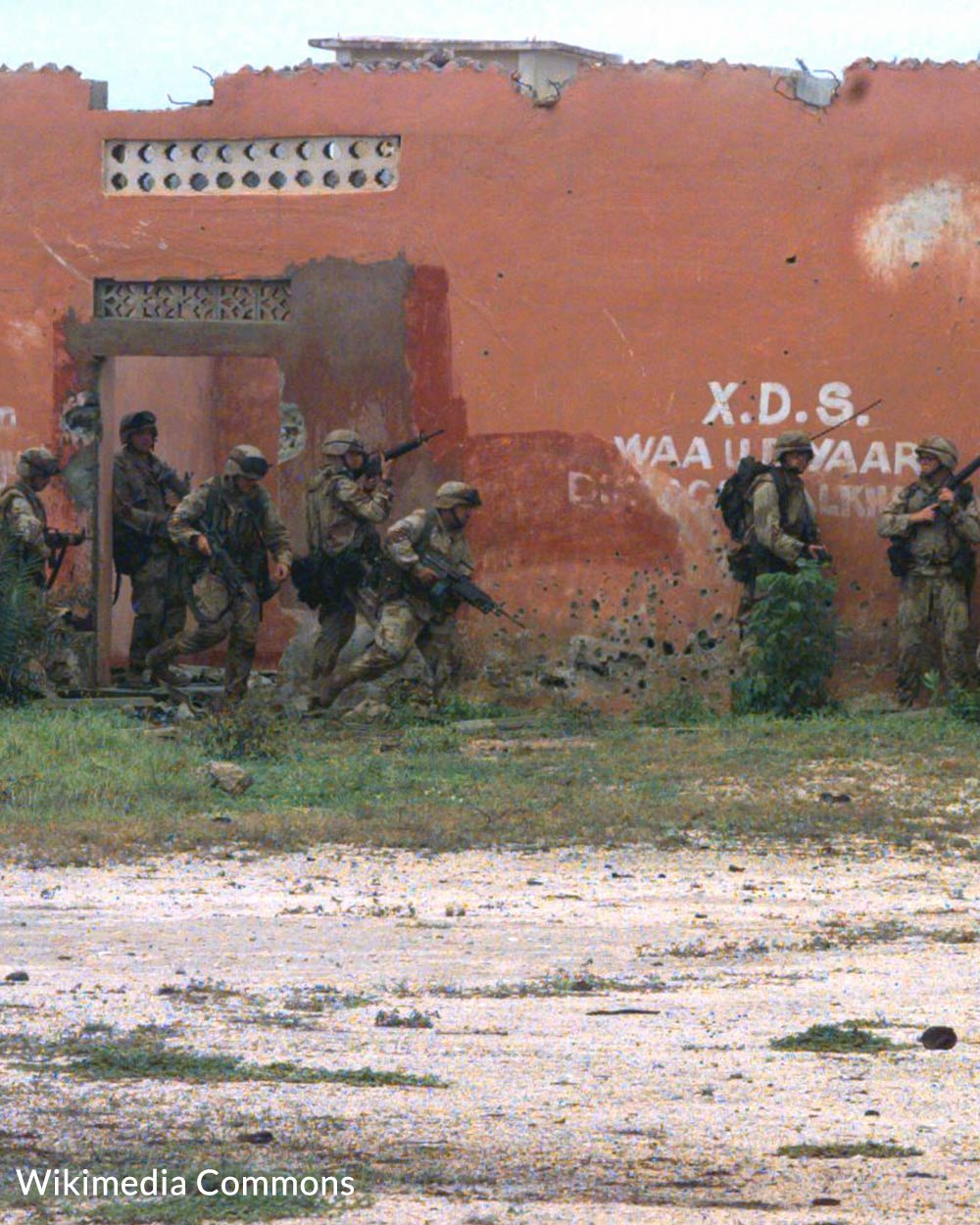 U.S. Marines search for a weapons cache in the Somali capital city of Mogadishu.