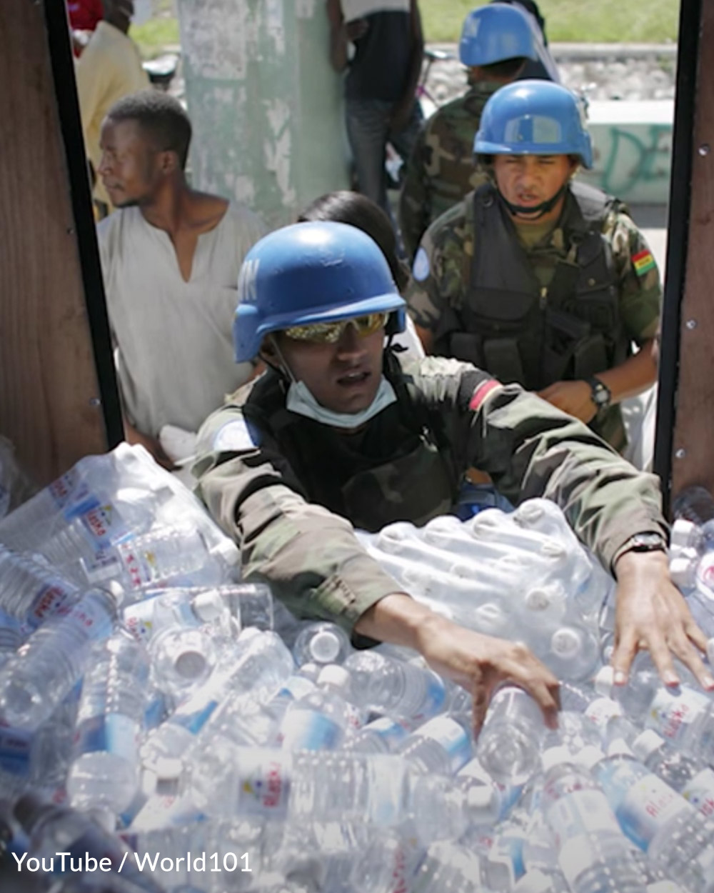 U.S. troops deliver water to people in need.
