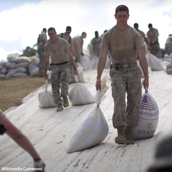 U.S. troops deliver aid to a foreign country.