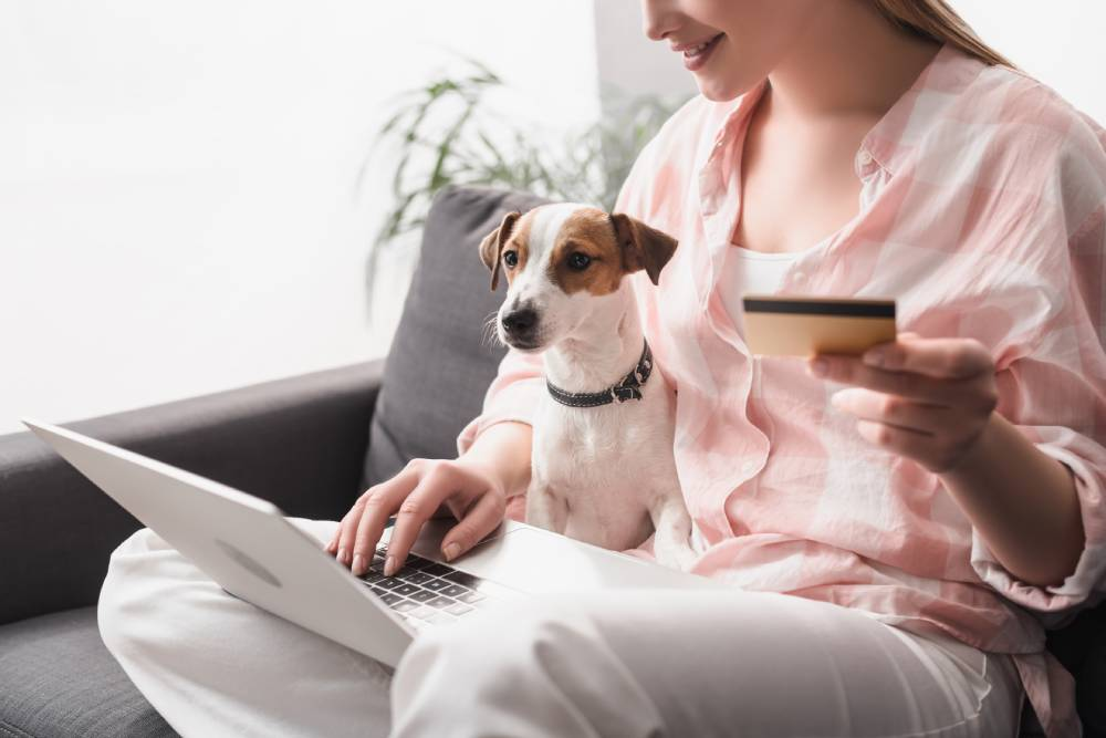 Woman online shopping with her dog