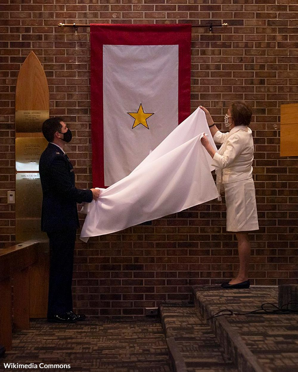 The Gold Star flag represents a service member who has died in active service.
