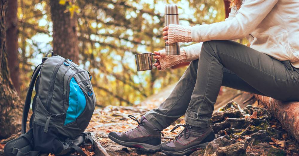 woman drinking coffee on a hike