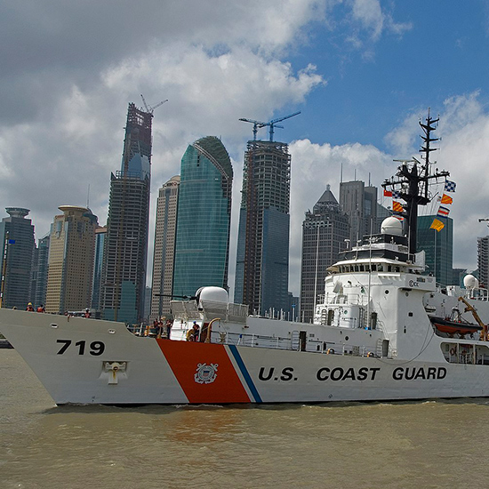 The crew of the U.S. Coast Guard Cutter Boutwell, a 378-foot High Endurance Cutter home ported in Alameda, Calif., bids farewell to the China coast guard.