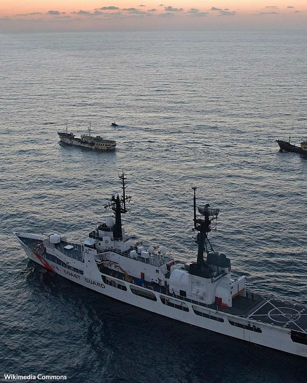 The U.S. Coast Guard Cutter Boutwell transfers custody of the Fishing Vessels Lu Rong Yu 1961 (right) and Zhe Dai Yuan Yu 829 (left) to a Chinese Fisheries Law Enforcement Command (FLEC) cutter after being interdicted for use of illegal high seas drift net fishing equipment.
